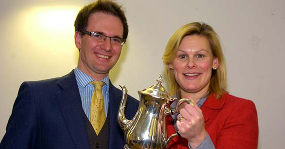 Charles Hanson and Kate Bliss with a silver teapot